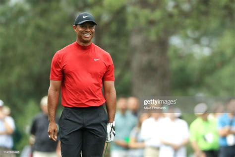 Tiger Woods of the United States smiles on the ninth hole ...