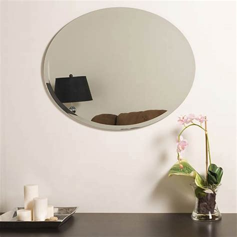 This wonderful oval mirror adds a vibrant element to any wall. Decor Wonderland Odelia Oval Beveled Frameless Mirror Ssm2228   Bellacor