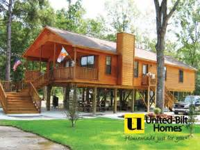 cabin built  piling foundation   stilt house plans house  stilts beach house plans