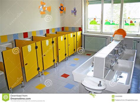 Bathroom And A Toilet With Small Sinks Asylum Stock Image