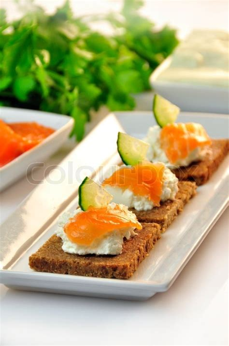 rye bread canapes canapes rye bread with ricotta cheese and smoked salmon stock photo colourbox