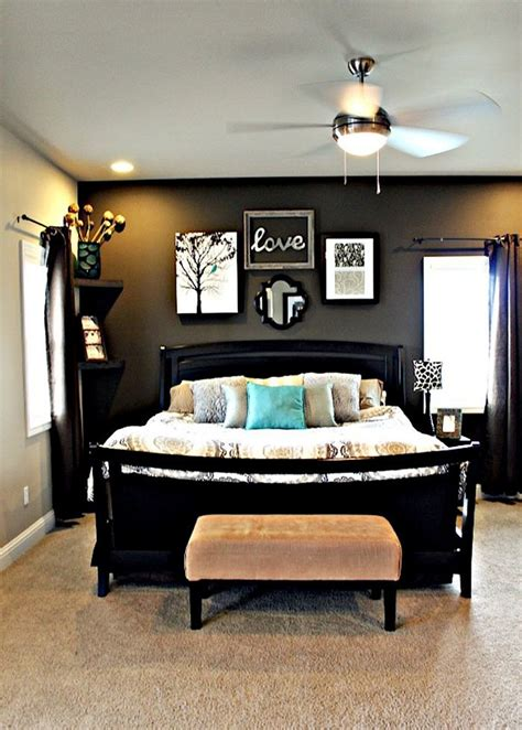 master bedroom with dark grey accent wall light grey