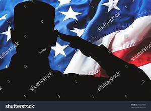 Proud Saluting Male Army Soldier On American Flag ...