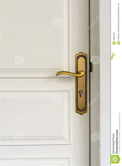 classic golden door handle on white door stock photo image 59859425