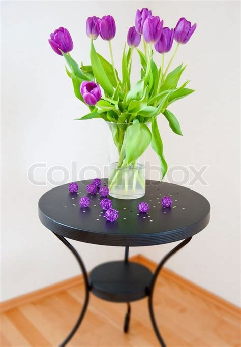 bouquet  purple tulips   glass stock photo