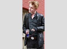 Macaulay Culkin holds hands with mystery brunette in Paris