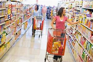 Two women shopping in supermarket grocery aisle | Stock ...
