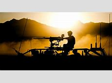 File40 Commando Royal Marines in Afghan Sunset at End of