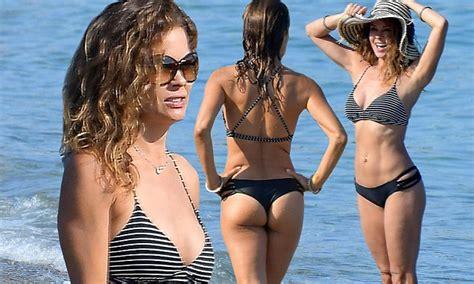 brooke burke highlights  midriff  derriere  bikini