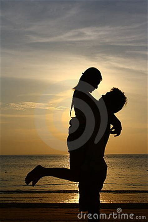 happy couple  sunset beach silhouette royalty