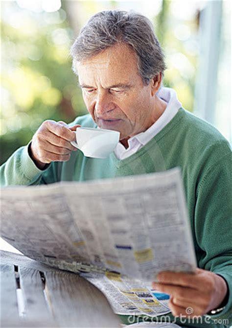 stock image retired  man reading newspaper  morning
