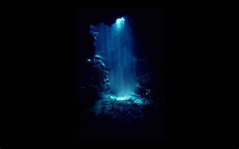 the cave and the light blue light in a cave wallpapers and images wallpapers