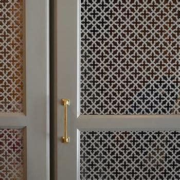 gray quatrefoil lattice cabinet doors mudroom cabinets