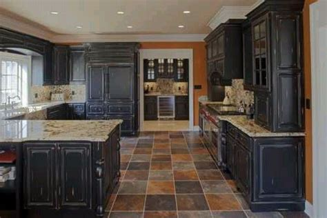 these cabinets with the colored slate floor are