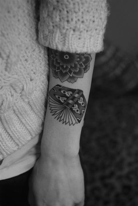 Flowers and book tattoo