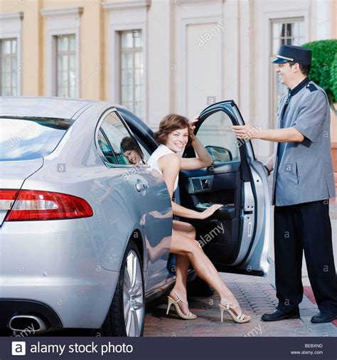 Hotel Porter Opening Car Door For A Woman, Biltmore Hotel
