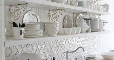 shabby chic kitchen wall tiles the wrought iron shelf supports really fit in this scheme i also love the tessellating tiles