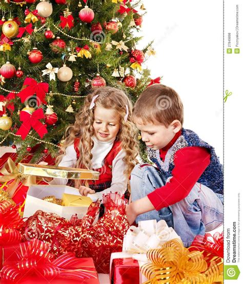 children with gift box near christmas tree royalty free