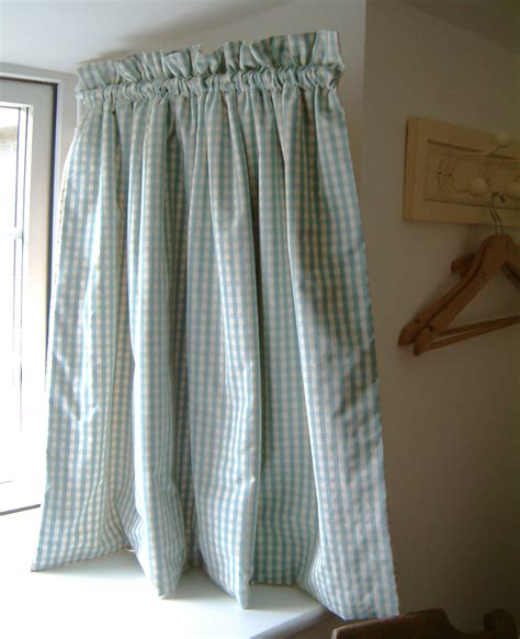 curtains with hinged dormer rod and contrast fabric on