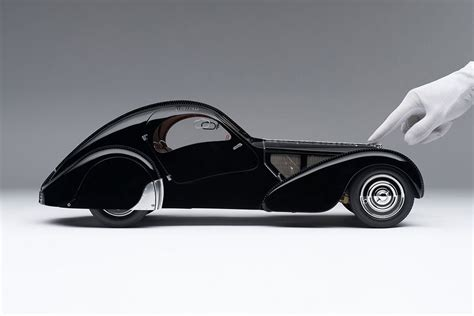 With an elegance of minimalism and refinement often only attributed to exclusive paris fashion designers, the bugatti la voiture noire is the object of desire for a hyper car. Bugatti 57sc Atlantic 1938 La Voiture Noir - 1:8 Scale Model Car - Billionaire Toys