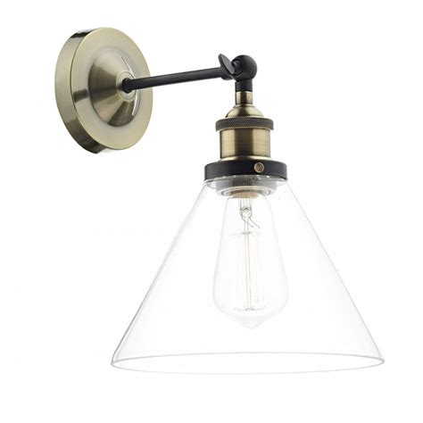 antique brass wall light with clear glass shade in vintage
