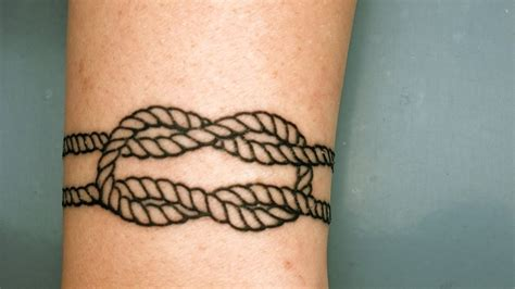 black outline square knot tattoo design  forearm wolf