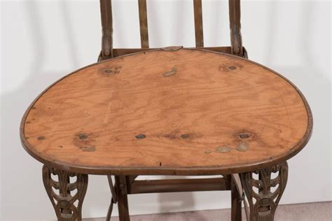 set of four nouveau cast iron folding chairs with wood