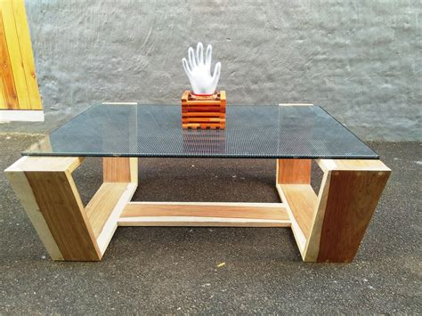 Wood is the primary material used for this table but the glass top made it look softer and more contemporary. We design and handcraft each project to perfection. Glass top coffee table with Kiaat/Walnut ...