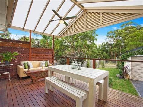 Photo Of A Indoor-outdoor Outdoor Living Design With Deck