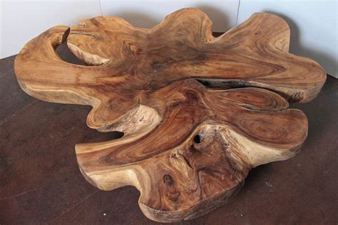 They source their beans through cooperatives that import fair. Organic Form Lychee Wood Coffee Table at 1stdibs
