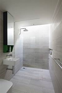 10 tips to make your bathroom look bigger tilejunket for Wet floor bathroom designs