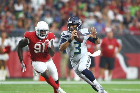 russell wilson stands    quarterback wins