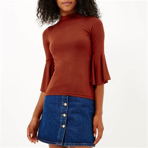 River Island Fluted Sleeve river island rust brown fluted sleeve turtle neck top in