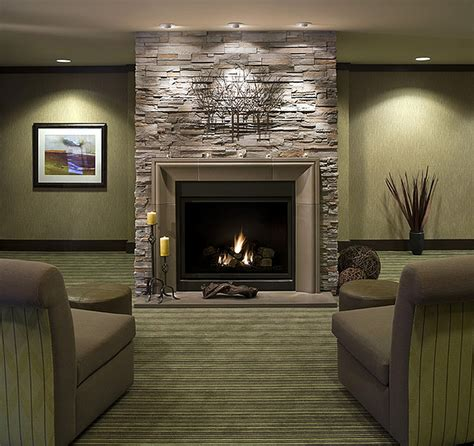 marble fireplace surround and wooden white mantel with lucite table and zebra archaic gray paint fireplace with floating oak log