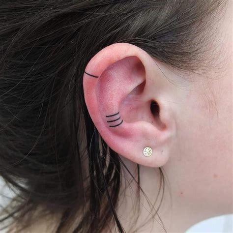 Minimalist Ear Tattoo Trend Has People Getting Tiny
