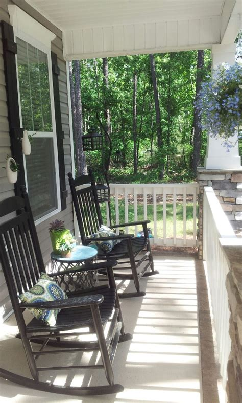 southern front porch design  black rocking chairs