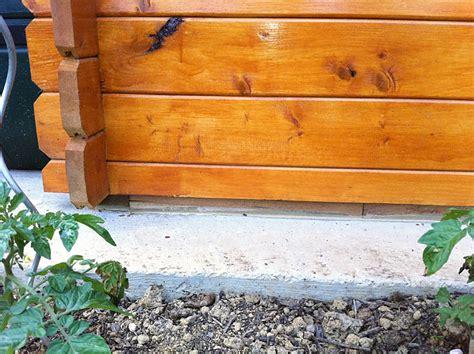 comment fixer un abri de jardin sur une dalle beton