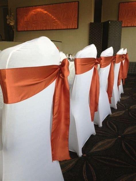 burnt orange sashes on white spandex chair covers weddi