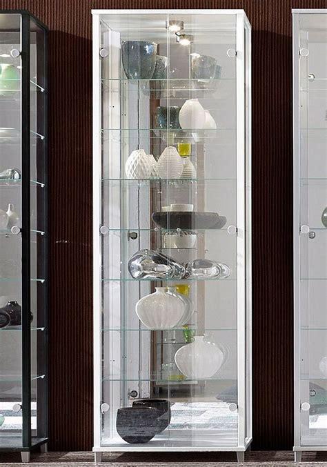 vitrine  tuerig mit spiegelrueckwand  glasboeden otto
