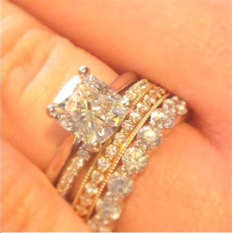 Stacked wedding bands are so in! Our newly-engaged jewelry