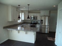 where to buy kitchen cabinets azul platino granite on brown cabinets kitchen 1717