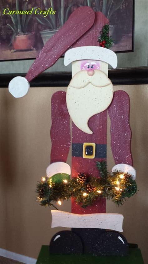 tall standing wood craft santa holding garland  lights