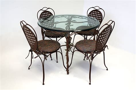 wrought iron glass top table four chairs cushioned painted