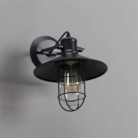 vintage wandlamp met zwarte metalen kooi selena kosilamp