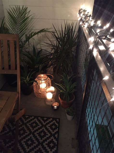 Tropical plants, candles, lanterns, string lights, small