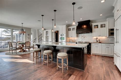 Gonyea Homes & Remodeling  Traditional  Kitchen. White Media Console. Pool Landscape Design. Wrought Iron Coat Rack. Textured Walls. Wine Themed Kitchen. 72 Inch Double Sink Vanity. Ceasarstone. Average Garage Door Size