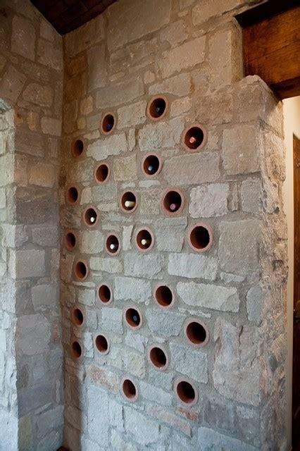 clay pipe wine rack mediterranean wine cellar austin