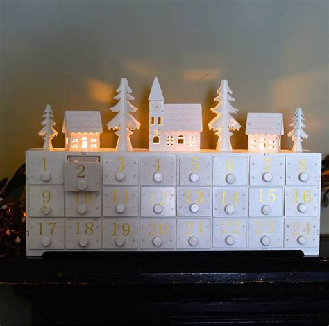 white battery christmas lights wooden led lit advent calendar by the forest co