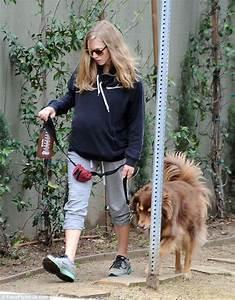 Amanda Seyfried radiant baby bump whilst walking dog Finn ...