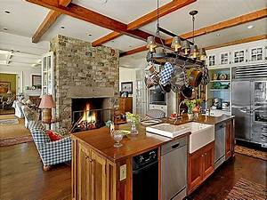kitchen with stone fireplace - Hooked on Houses